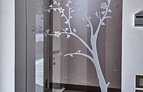 porta a battente decoro pesco vetro trasparente temperato